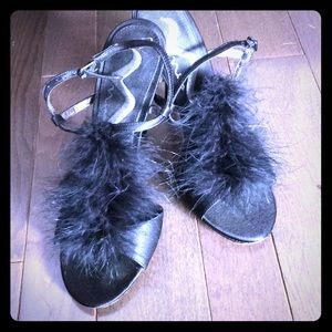 Black heels with feather accent